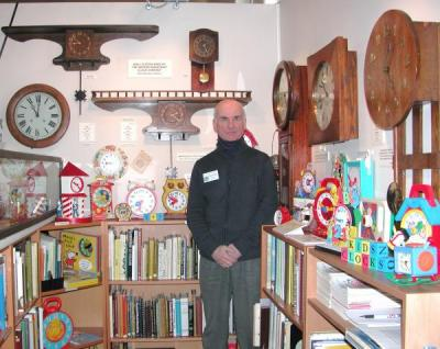 Allan Symons, founder, standing in the museum's reference library.