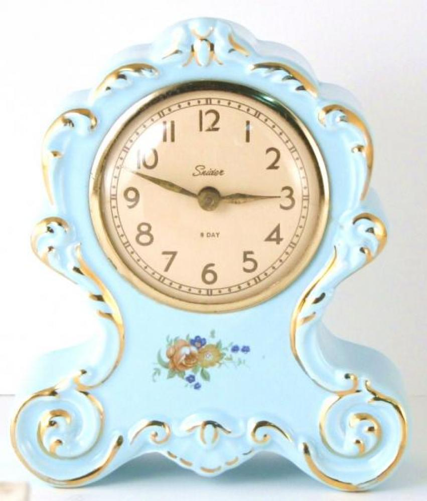 Snider powder blue version, china-cased mantel clock (8-day windup, 1950s)