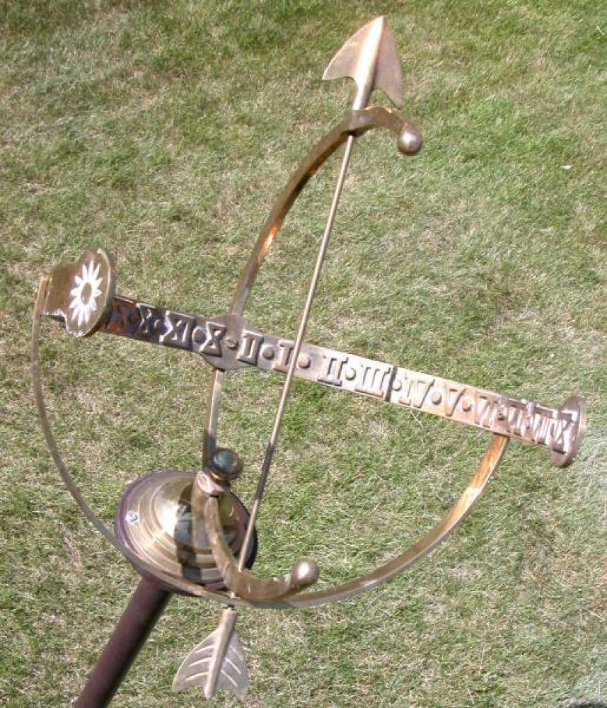 Closeup of armillary sundial showing time almost 3:30 p.m.