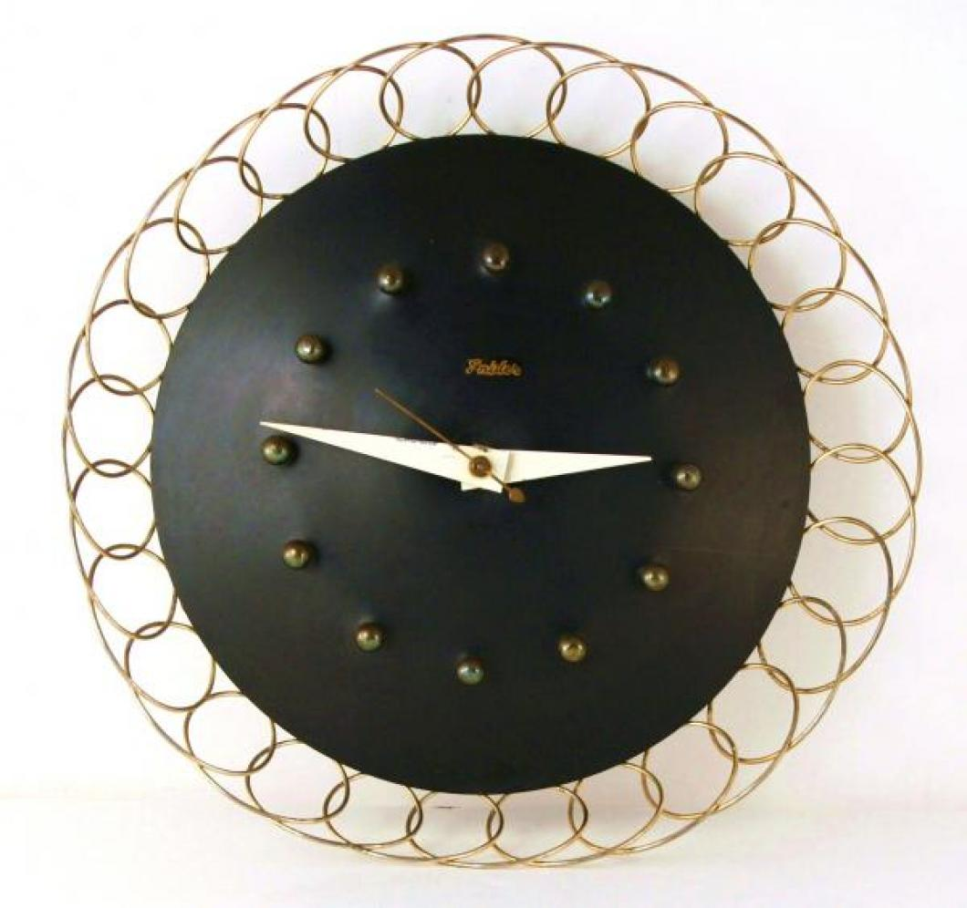 Snider basket-style wall clock with wire loop framing (electric, late 1950s)