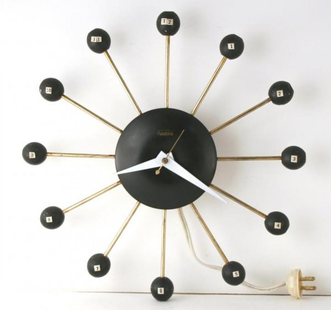 """Snider black """"atomic"""" wall clock - numbers added by previous owner (electric, late 1950s)"""