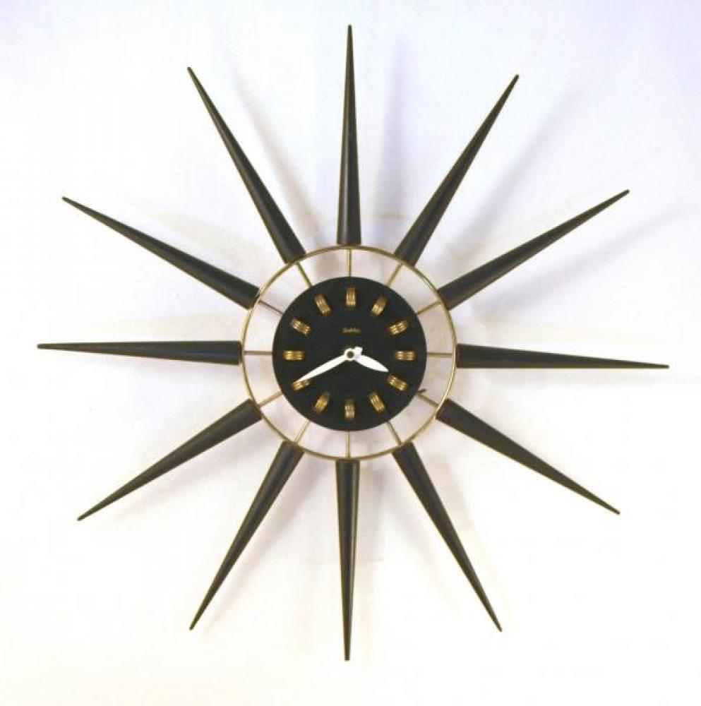 Snider large starburst wall clock, simple design with black dial and 12 long wood cones, black finish (early/mid 1960s, electric, part of the Spanish series)