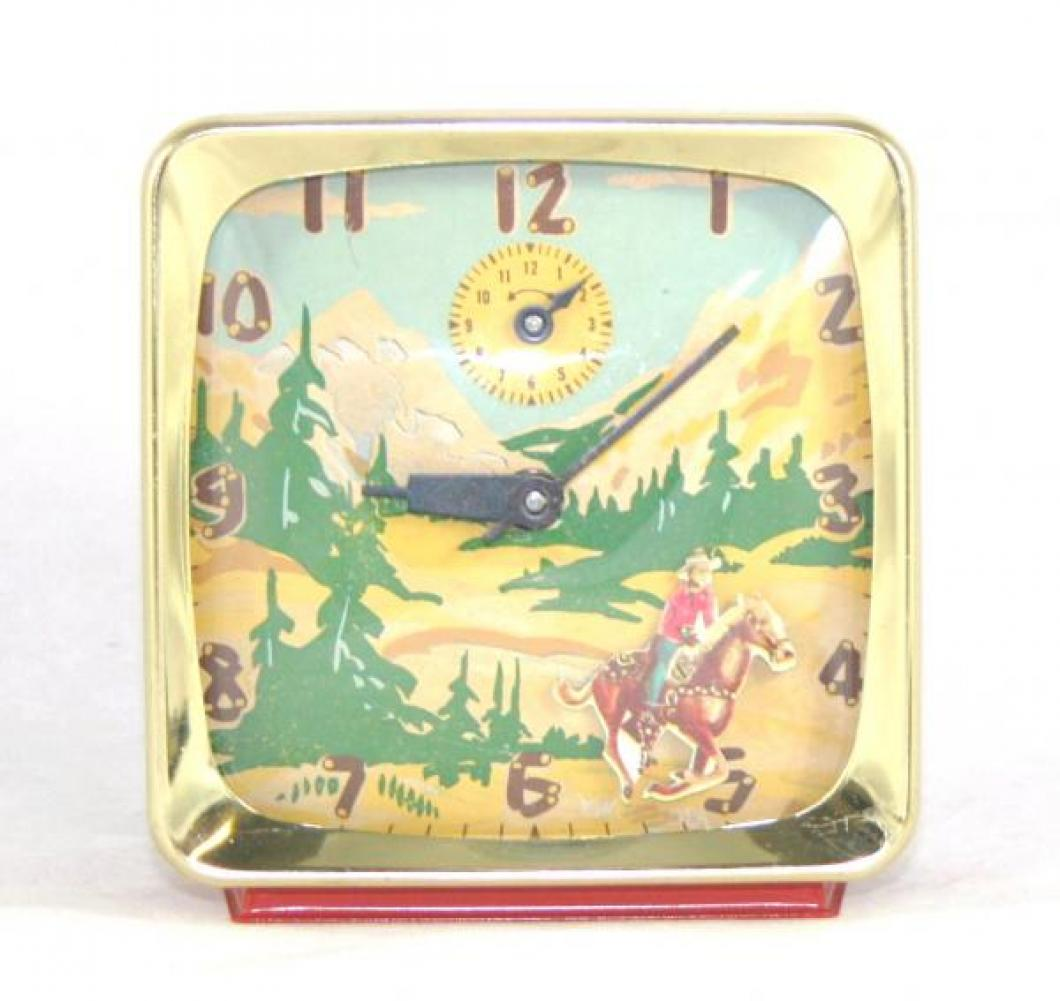 "Ingraham ""The Westerner"" model animated alarm clock with red-painted metal case (windup, 1950s) [similar model in United States is Roy Rogers riding Trigger in desert with cactus]"