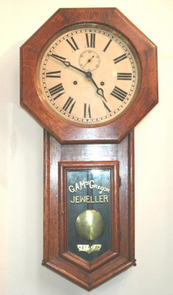 "Pequegnat ""Regina"" model wall clock - example shown here has the name of the jeweller who sold it inscribed over the pendulum"