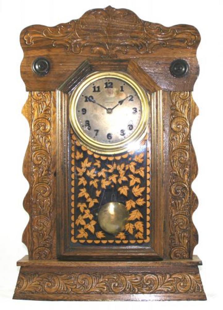 "Pequegnat ""Canuck"" model mantel clock - brass face"