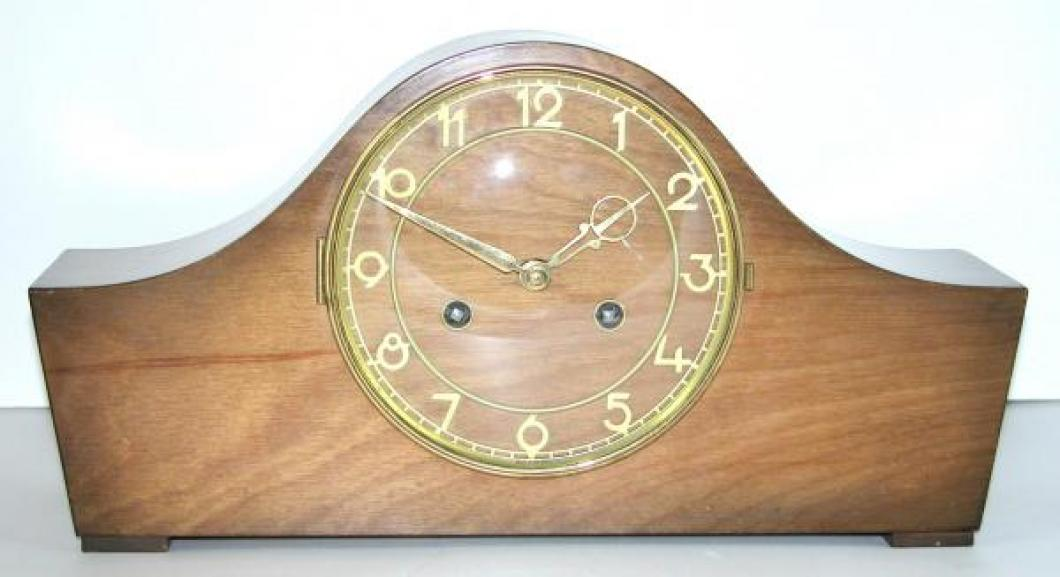 Style 103 postwar mantel clock, stained birch wood case.