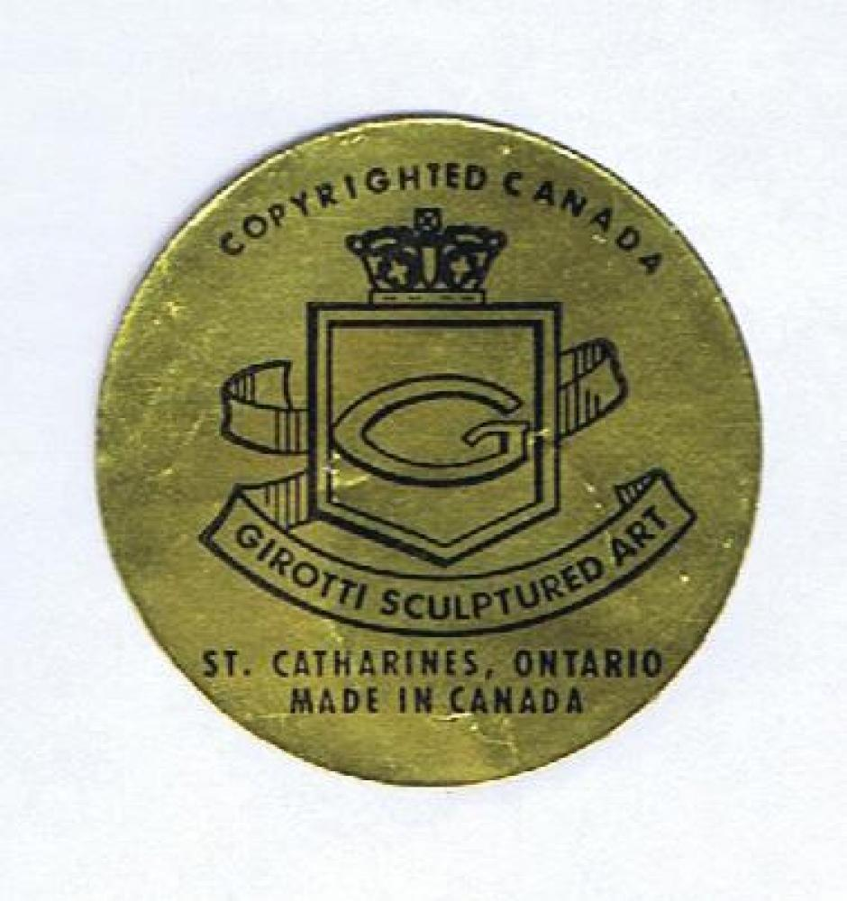 "Typical round foil label on back of wall clocks and plaques (1 1/2"" diameter)"