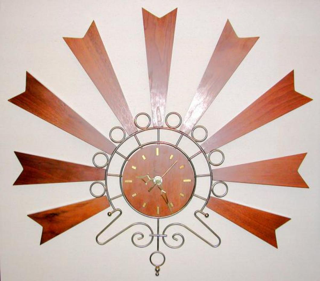 "1960s fan-shaped battery wall clock, walnut dial and rays, 25"" W (museum collection)"