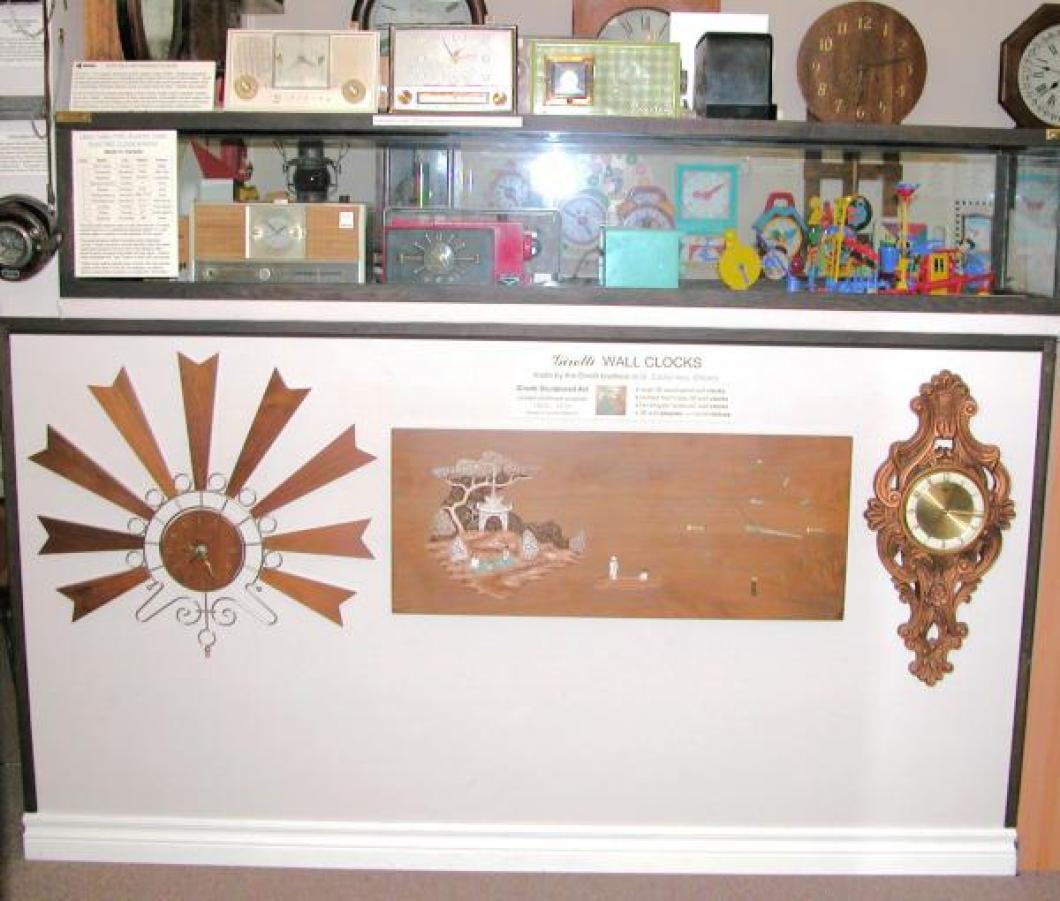 Girotti wall clocks new exhibit June 2014 (below Canadian-made 1950s tubes clock radios)