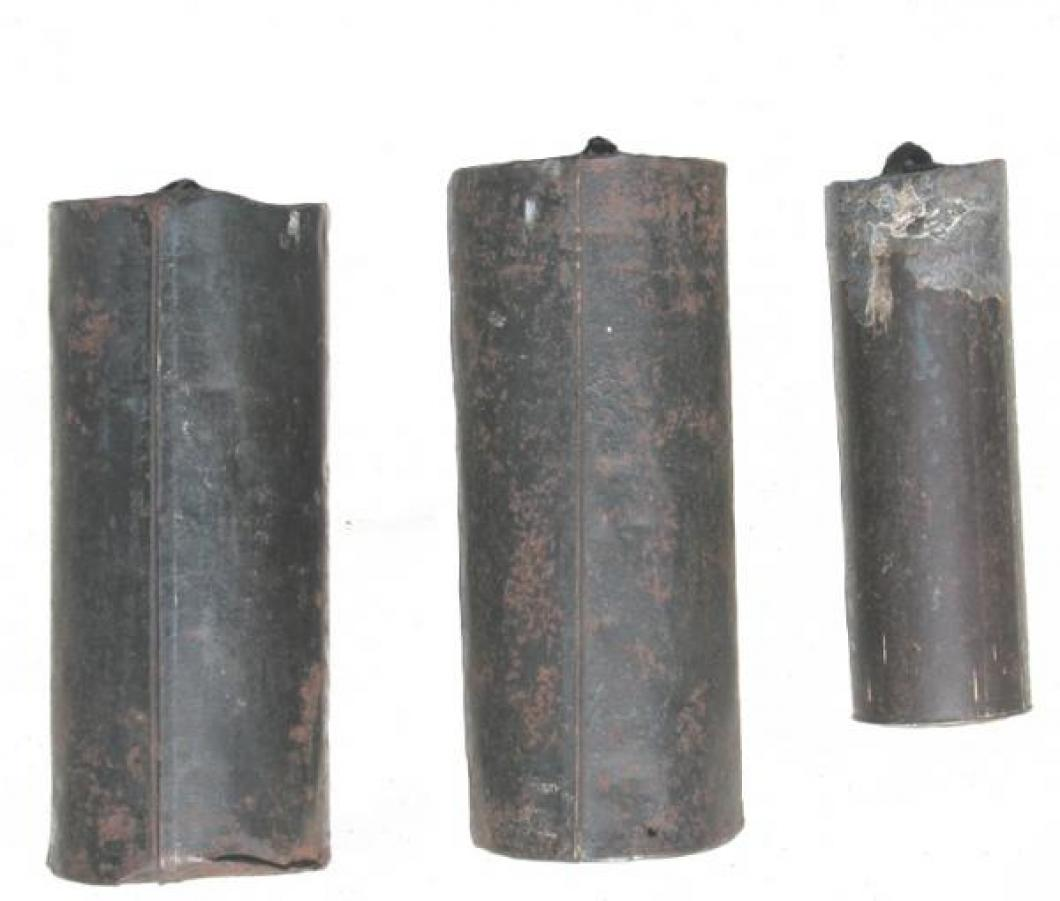 The three  weights removed to photograph:  two large tin cans filled with stones (time and strike trains), and the smaller lead weight (for the quarter-hour bells gear train).