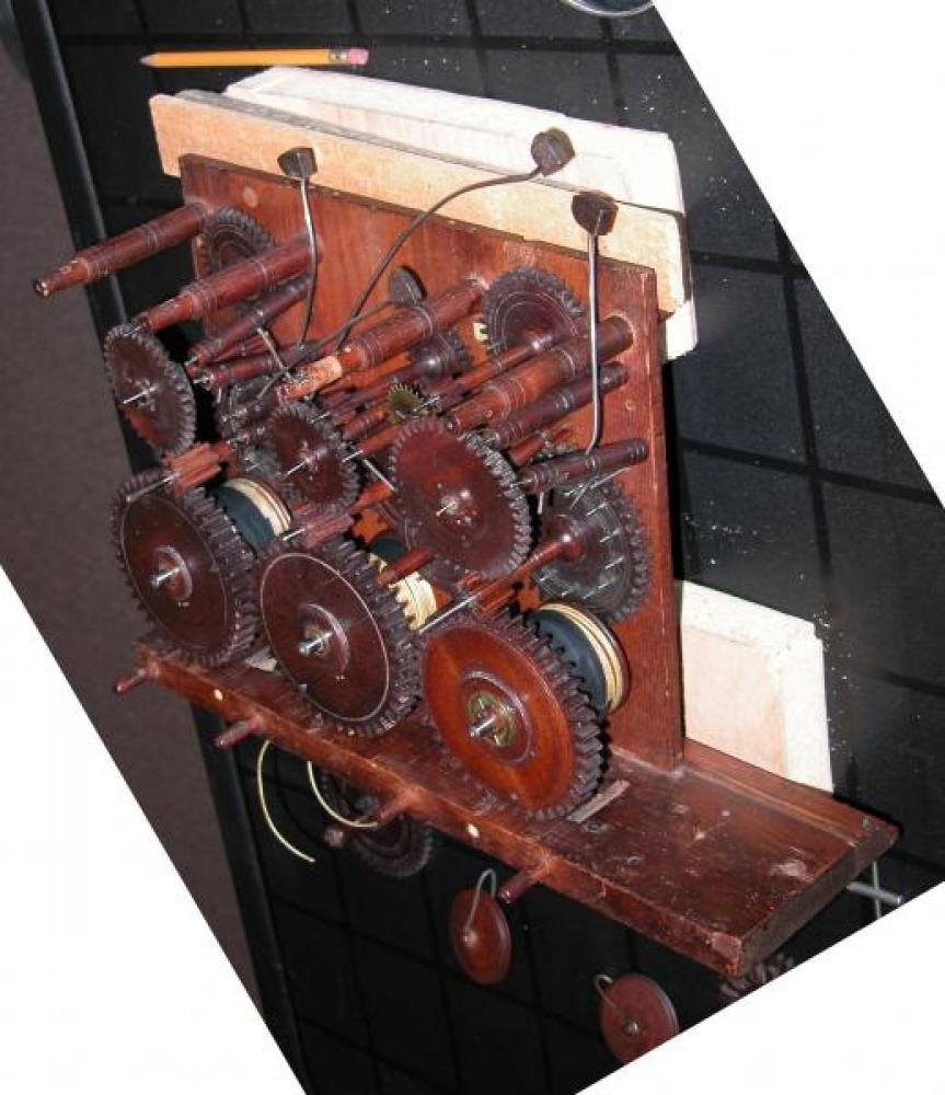 A view of the wood gears in the movement, with the front plate removed.