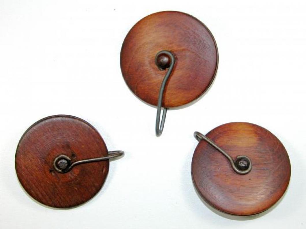 The three wood pulleys for the weights cables
