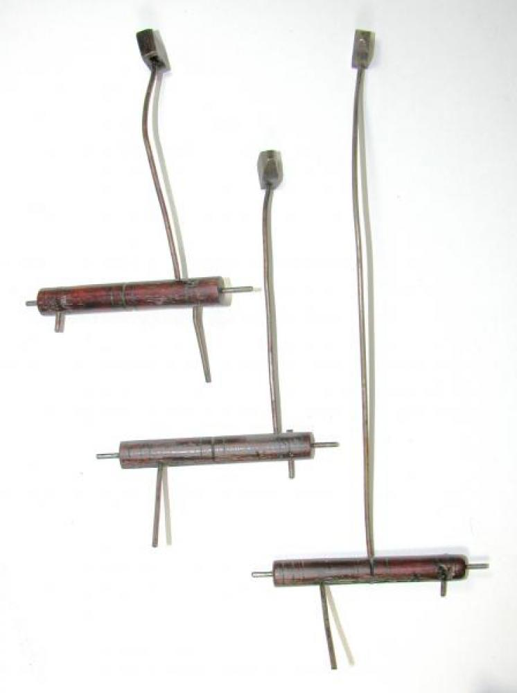 The hammers for the three quarter hour bells; note the wood barrels.