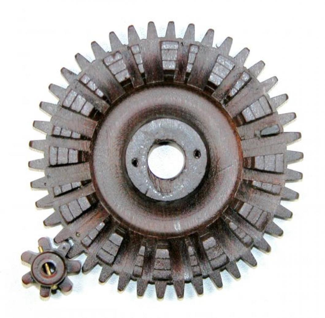 Large and small wood gears meshed (petite sonnerie count wheel).