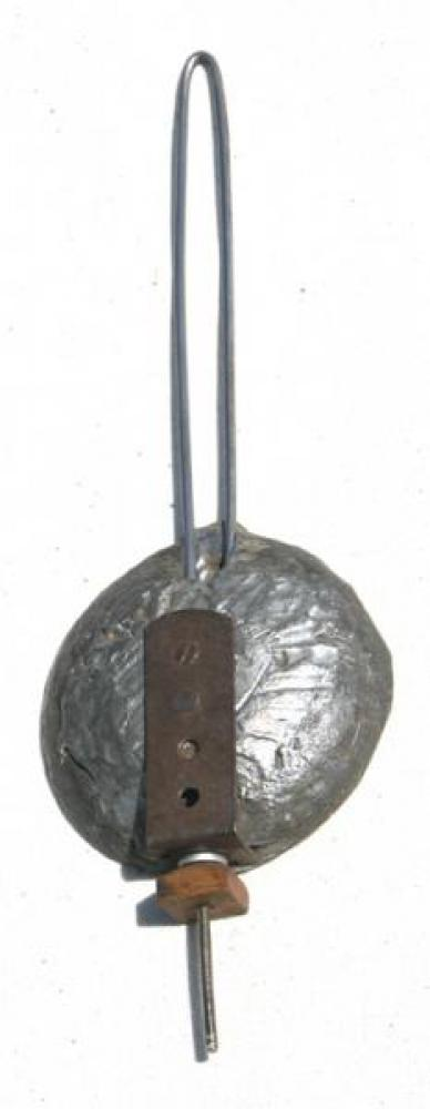 The concave front side of the cast lead pendulum bob.