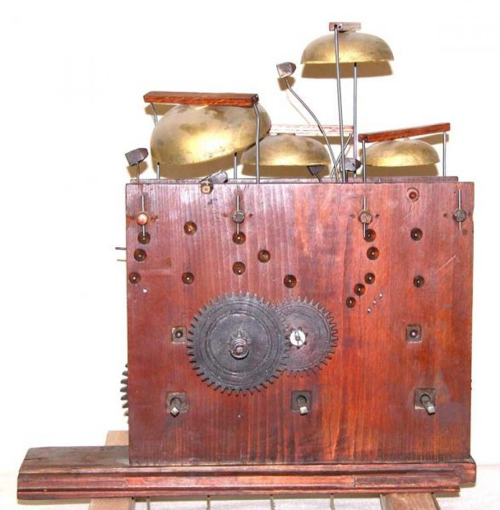 Front view of the wood movement, with the four replacement bells in place.