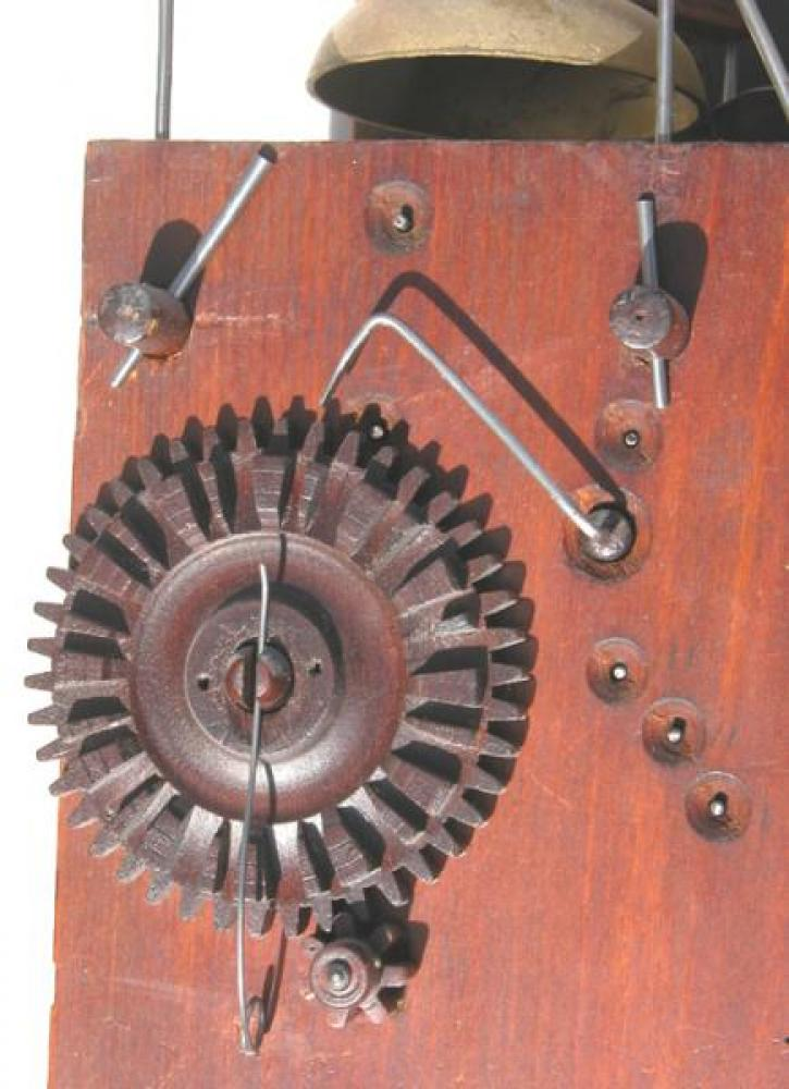 """Close-up of the wood count wheel for the quarter hour """"petite sonnerie""""."""