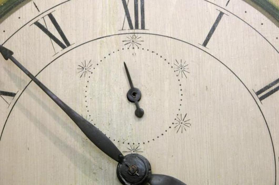 The seconds hand area of the wood main dial.