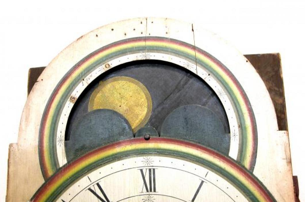 The wood moon phase dial above the main dial.