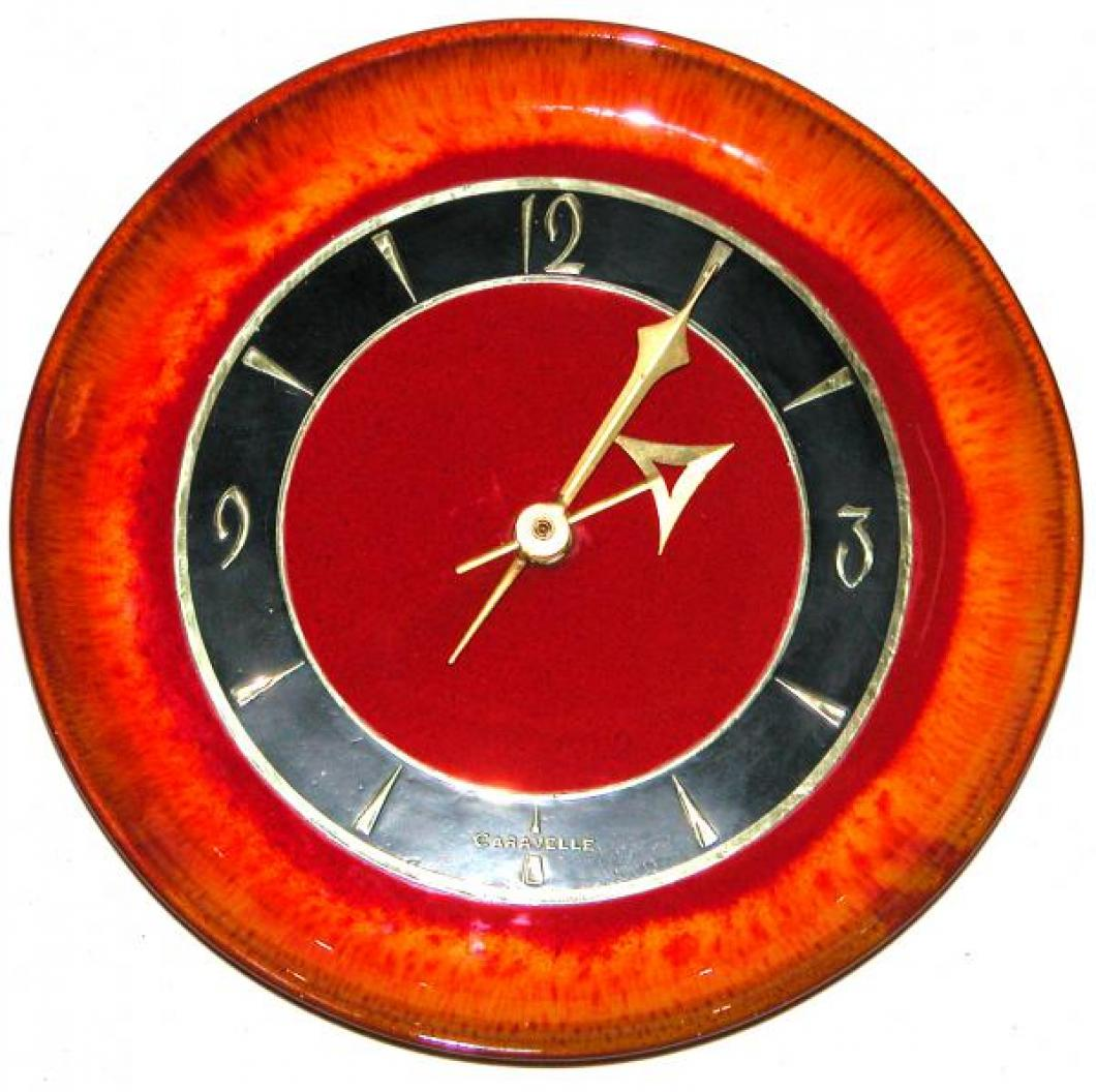 Red version Caravelle round plate model battery wall clock.