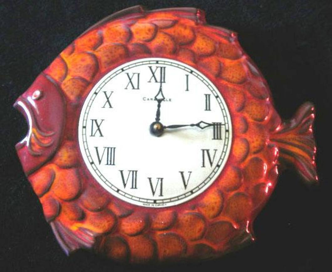 Online picture of the red version of the Caravelle fish model battery wall clock (museum still looking for one).
