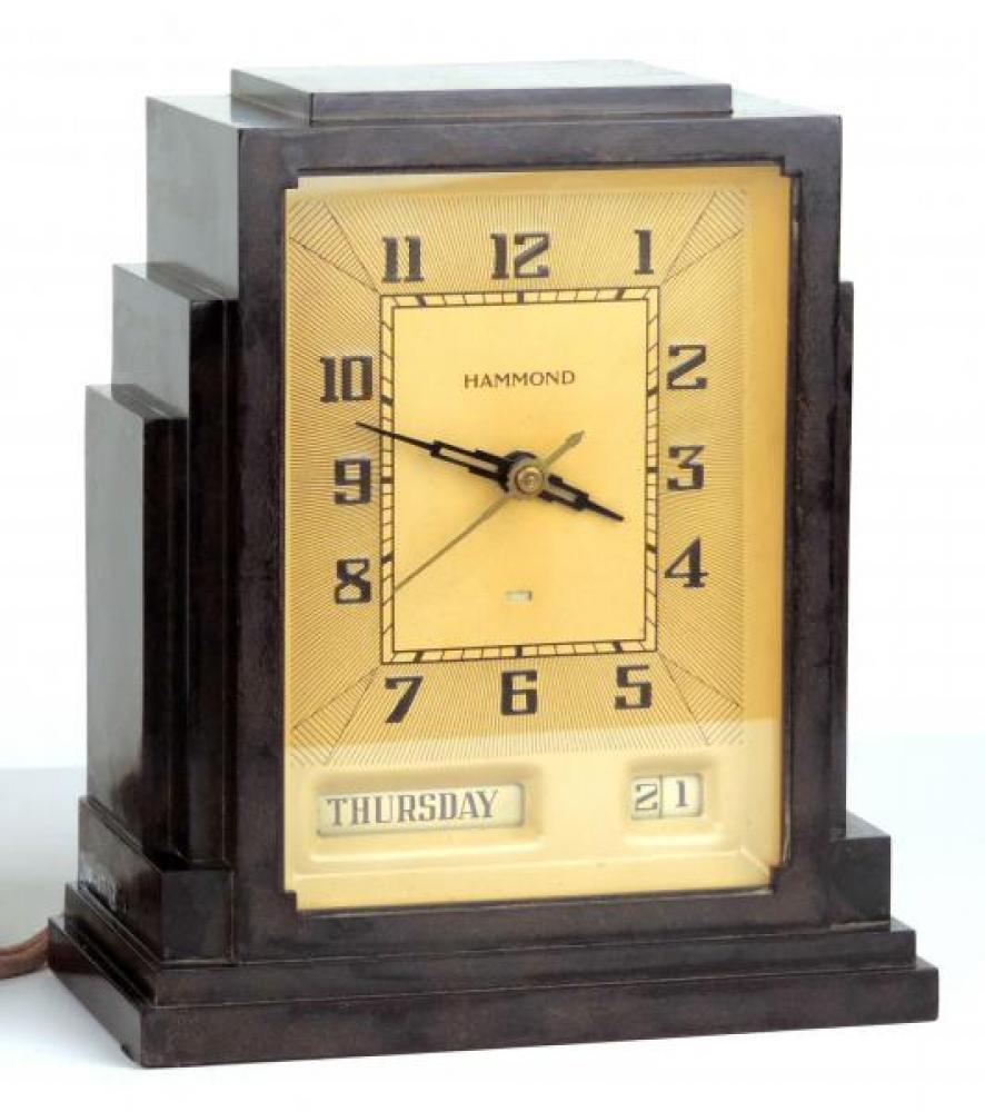 Tan dial GREGORY model mantel clock.