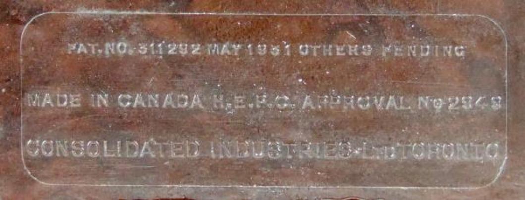 Embossed label on bottom of brown HAMMOND JUNIOR plastic case.