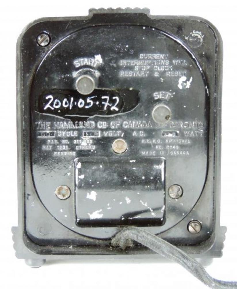 Back of black plastic HAMMOND JUNIOR model mantel clock.