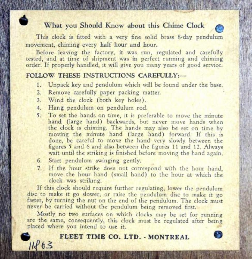 "Paper label inside back door of Fleet ""humpback"" mantel clock"