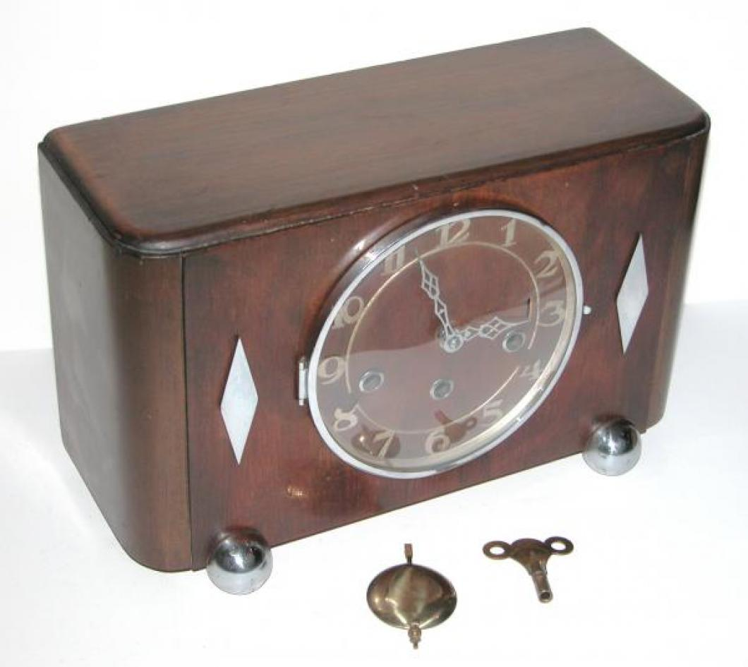 FLEET walnut case mantel clock with chromed ball feet and diamond appliques