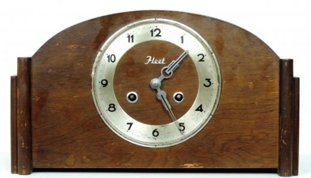 FLEET mantel clock with foil label on back (glass and bezel missing)