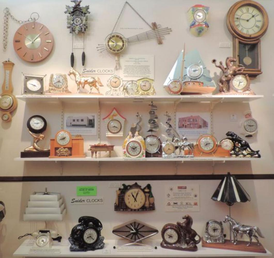 Mostly 1950s Snider (Toronto) windup and electric shelf clocks, including TV lamp clocks.
