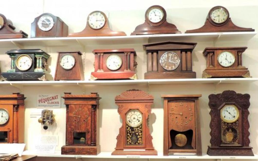Three shelves of 100% Canadian-made mantel clocks in the PEQUEGNAT ROOM.