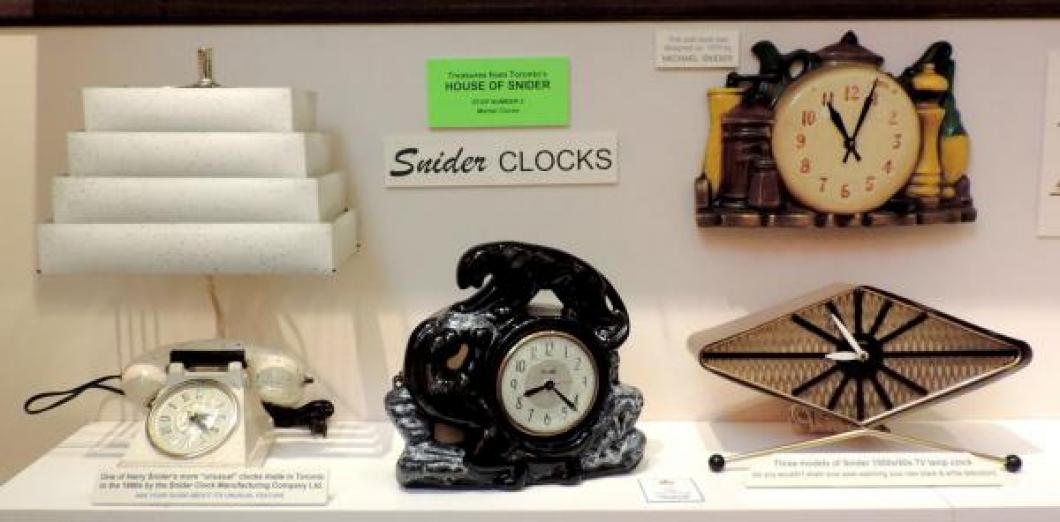 Three Snider 1950s lamp clocks and a ca. 1970 molded-case battery wall clock.