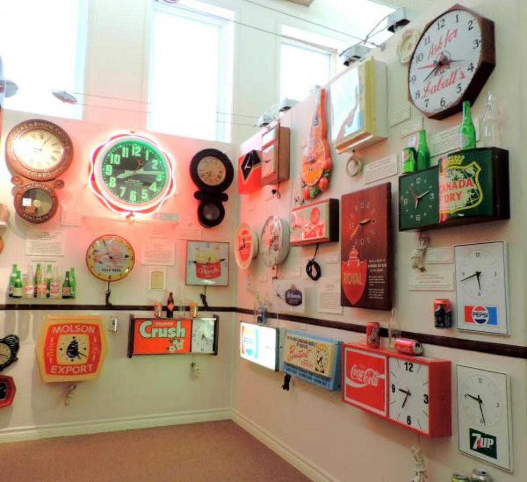 Many mostly 20th century Canadian-made electric advertising wall clocks.