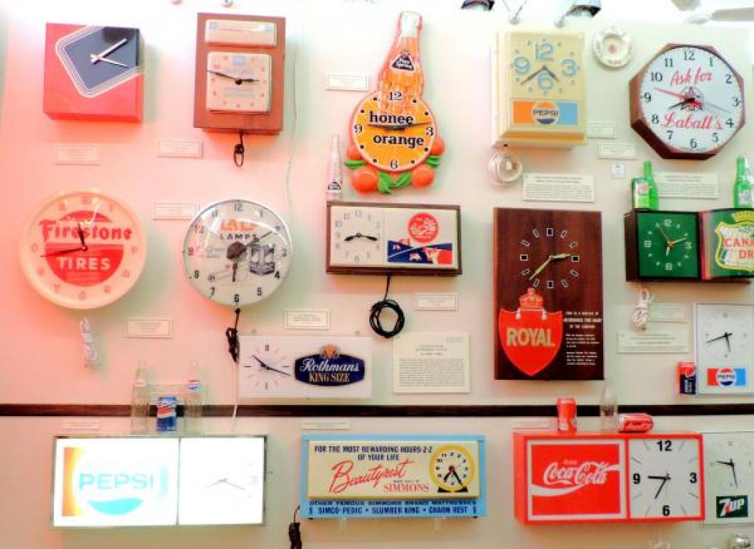 Canadian-made 1950s/70s electric advertising wall clocks.