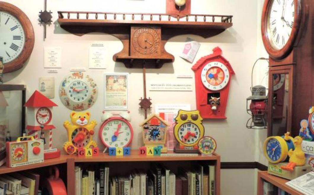 Some kids' clocks on display in the museum's reference library (Pequegnat WOODSTOCK model on the wall).