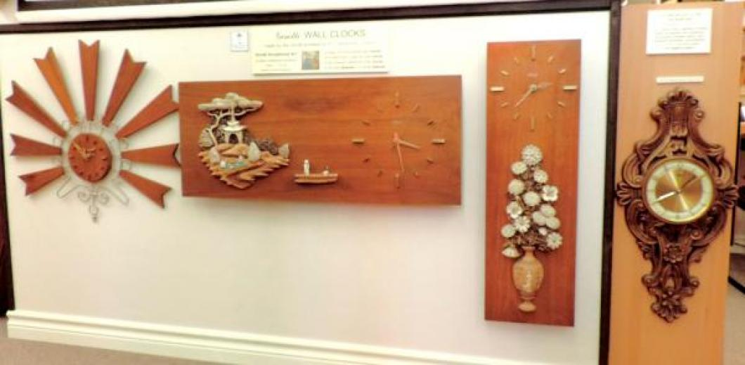 Four wall clocks made in the 1960s/70s by Girotti Scupltured Art in St. Catharines, Ontario.
