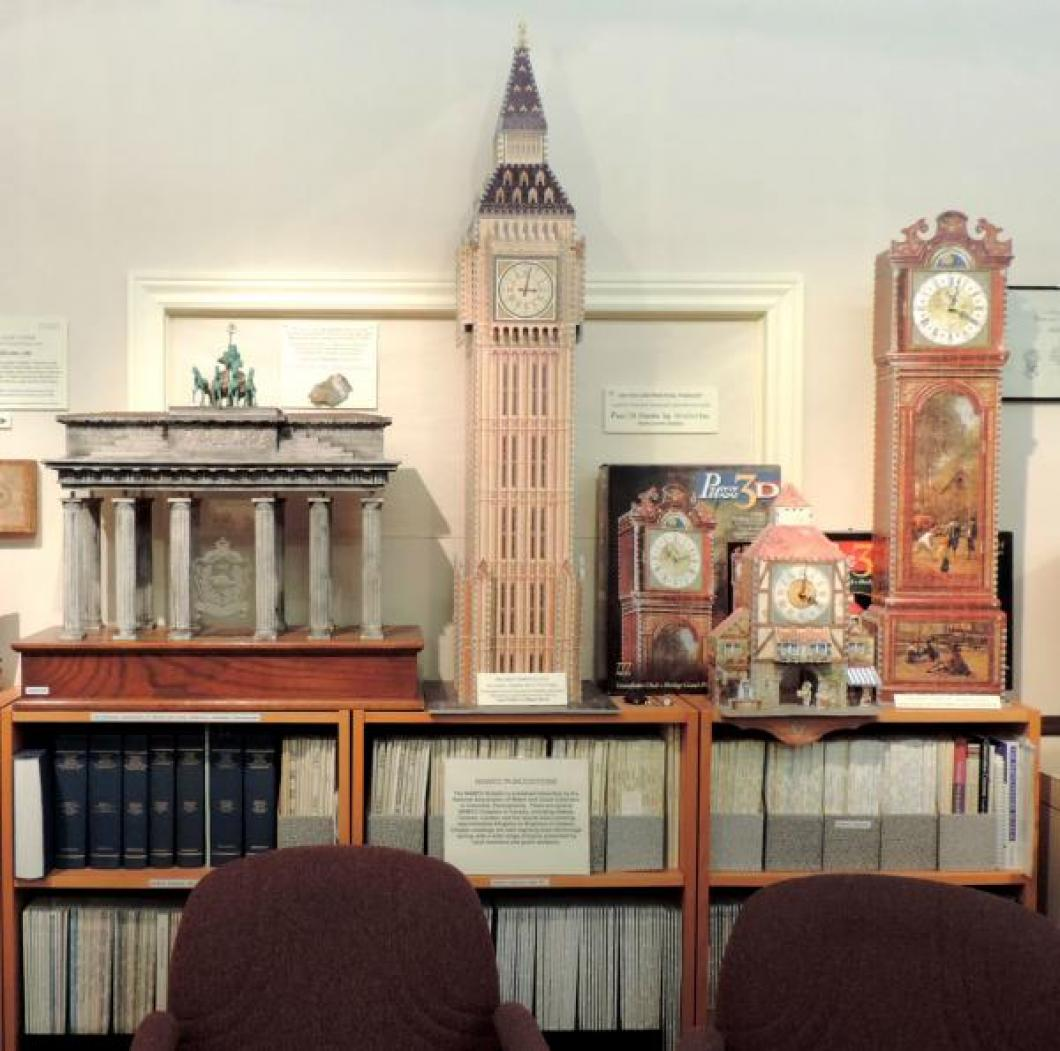 Three Canadian Puzz3D jigsaw puzzle clocks and Brandenburg Gate model clock (by Werner Friedrich) with Pequegnat pendulum movement (being restored).