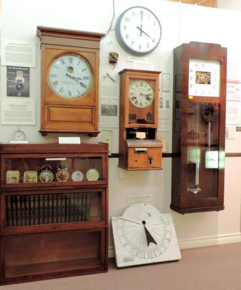 Visitors can print a souvenir clock in / clock out card on the 1930s Blick Time Recorders (U.K.) Canada employee clock (centre).  At left, Stromberg Canada 1930s master clock; at right, IBM Canada 1950s master clock.