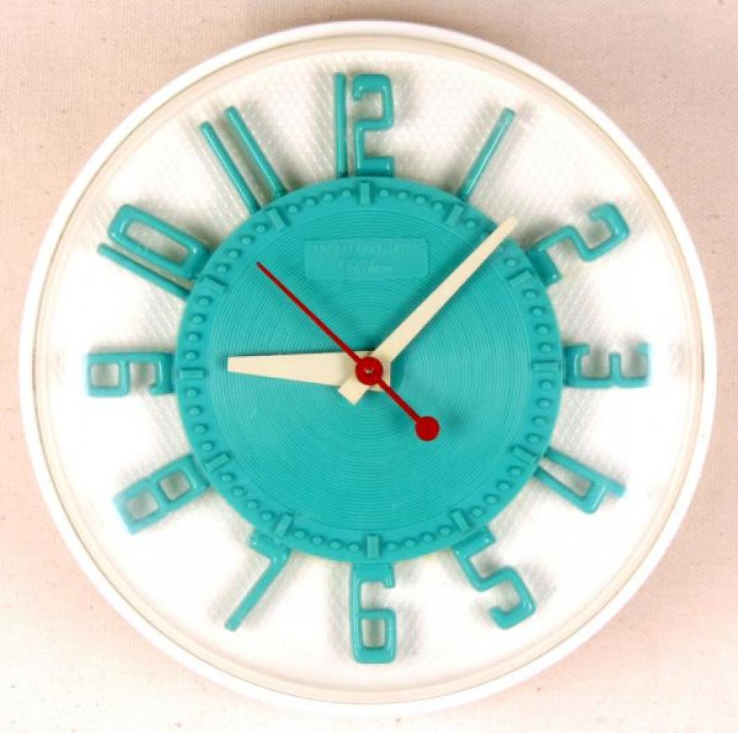 Model LK-104 turquoise and white version KITCHEN-MATE model kitchen clock, dates unknown