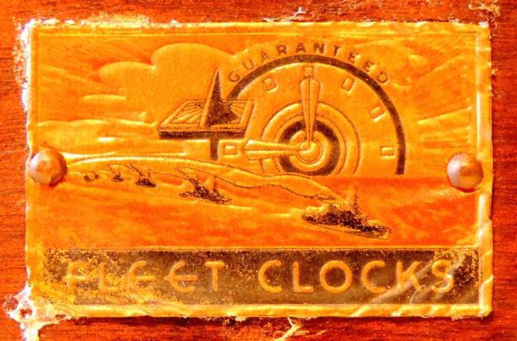 foil label on back of stepped ends wood case mantel clock