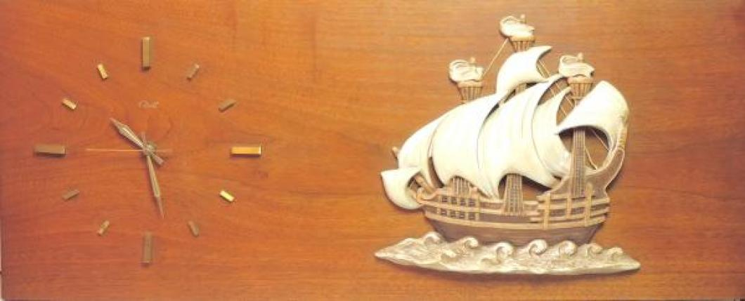 """wood panel clock with molded chalkware sailing ship (33"""" W x 13 1/2"""" H, acquired October 2018)"""