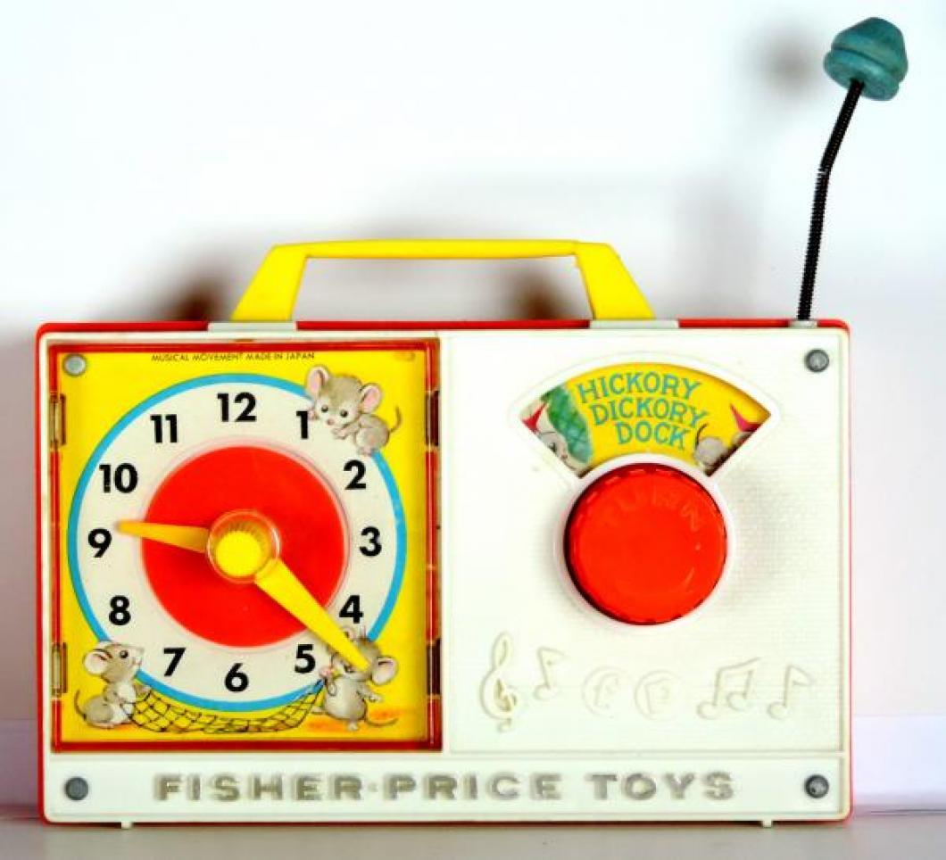 Fisher Price 1960s toy clock radio, windup music box, hands turn