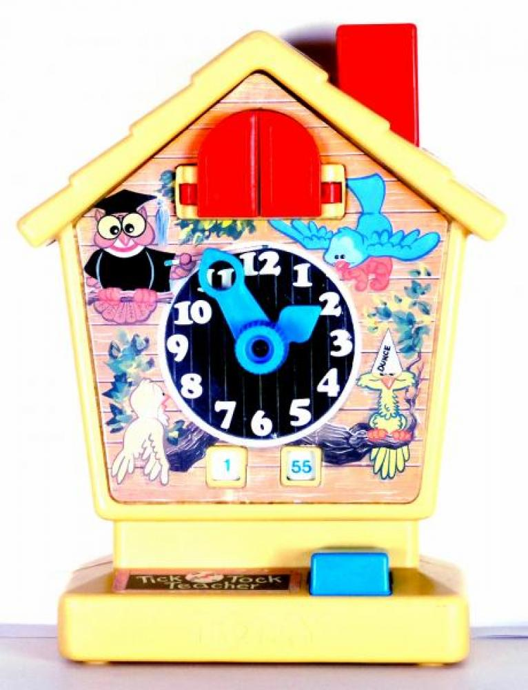 TOMY Tick Tock Teacher, analogue dial, digital time in small windows, red doors open and yellow bird pops out when chimney is pushed down