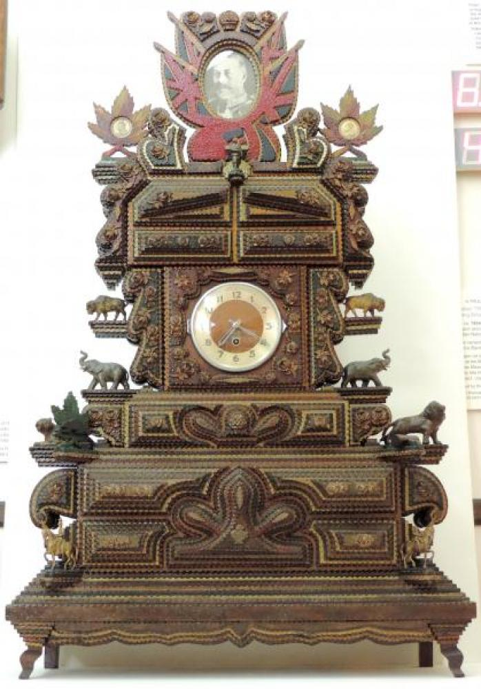 """Front of the Harry Sykes 1934 'tramp art' clock (38"""" high, 24"""" wide)"""